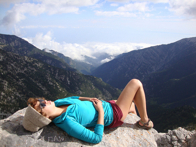 student resting on mountain